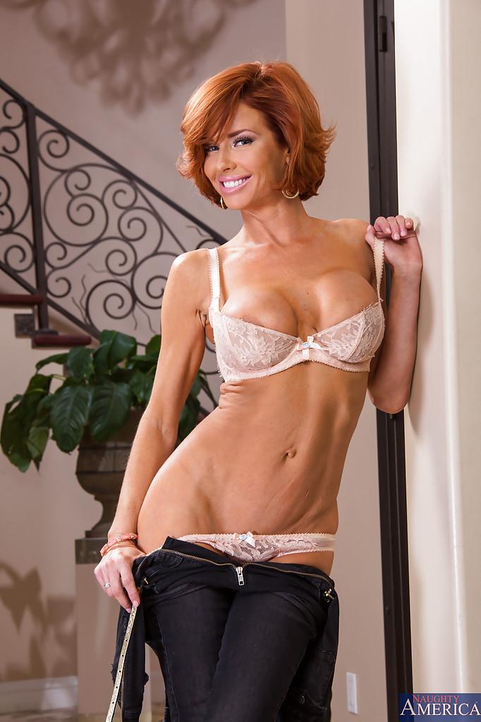 Beautiful slim sporty mature red hair stock photo