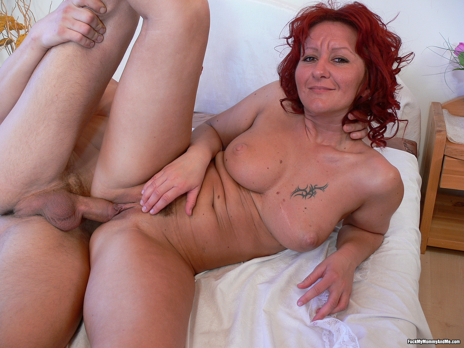 Gorgeous mature red head in stockings